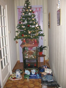 My mother-in-law's tree, with crêche and slippers underneath.